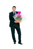 Businessman with vase of flowers Stock Images