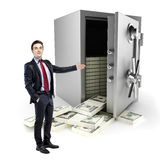 Businessman and vault with a lot of money inside Stock Image