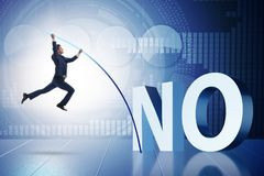 The businessman vaulting over word no Royalty Free Stock Photography