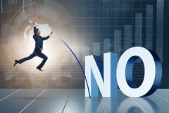 The businessman vaulting over word no Stock Image