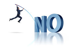 The businessman vaulting over word no Royalty Free Stock Photo