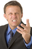 Businessman Very Angry. Businessman Looking Very Angry At Camera Royalty Free Stock Images