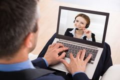 Businessman video chatting Stock Photography