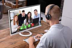 Businessman Video Conferencing On Computer. Businessman Video Conferencing With His Colleagues On Computer stock images