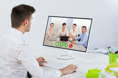 Businessman Videoconferencing With Colleagues Stock Images
