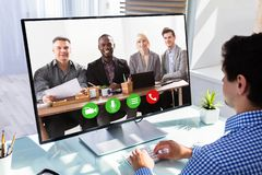 Businessman videoconferencing with his colleagues royalty free stock photos