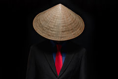 Businessman in Vietnamese conical hat Stock Images