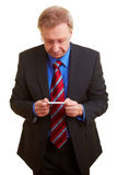 Businessman viewing a business card Royalty Free Stock Images
