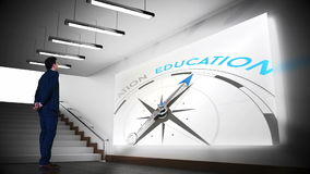Businessman viewing education compass clip stock video footage