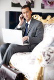 Businessman On A Vintage Sofa Stock Photo