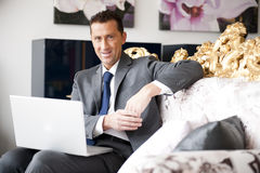 Businessman On A Vintage Sofa Royalty Free Stock Photography