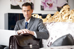 Businessman On A Vintage Sofa Royalty Free Stock Photos