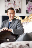Businessman On A Vintage Sofa Royalty Free Stock Photo