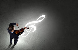 Businessman with violin Royalty Free Stock Photo