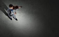 Businessman with violin Stock Photos