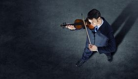 Businessman with violin Royalty Free Stock Photography