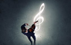 Businessman with violin Stock Images