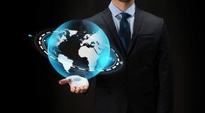 Businessman with virtual earth projection Royalty Free Stock Photography