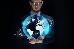 Businessman with virtual earth projection Royalty Free Stock Image