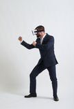 Businessman in virtual reality glasses in fighting pose Royalty Free Stock Photography