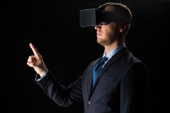 Businessman in virtual reality glasses or headset Royalty Free Stock Photo