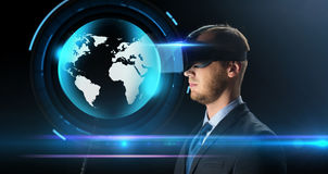 Businessman in virtual reality glasses or headset Royalty Free Stock Images