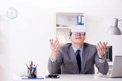 The businessman with virtual reality glasses in office. Businessman with virtual reality glasses in office Stock Images