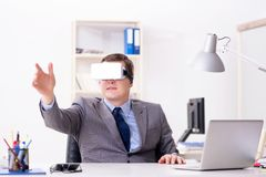 The businessman with virtual reality glasses in office. Businessman with virtual reality glasses in office Royalty Free Stock Photo