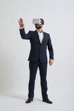 A businessman in virtual reality glasses touches something Stock Photo