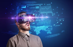Businessman with virtual reality goggles Royalty Free Stock Photos