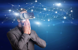 Businessman with virtual reality goggles Stock Photo