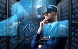 Businessman in virtual reality headset with charts. Business, people and technology concept - businessman in virtual reality headset with charts on screen Royalty Free Stock Photography