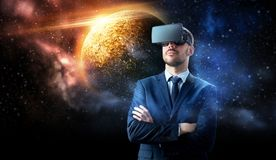 Businessman in virtual reality headset over space. 3d technology, virtual reality, cyberspace and augmented reality concept - young businessman with virtual Royalty Free Stock Images