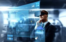 Businessman in virtual reality headset and screen. Business, augmented reality and future technology concept - businessman in virtual headset and screen over Stock Images