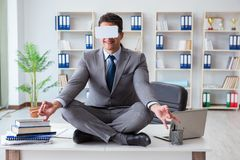 The businessman in virtual reality vr glasses meditating at desk top. Businessman in virtual reality VR glasses meditating at desk top Royalty Free Stock Photos