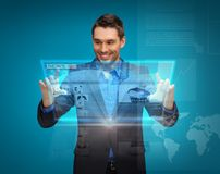 Businessman with virtual screen Stock Photography