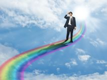 Businessman vision. Businessman stand on a rainbow way Royalty Free Stock Image