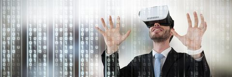 Composite image of businessman with vr glasses gesturing against white background. Businessman with vr glasses gesturing against white background against Stock Photography