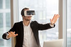 Businessman in vr headset touching air immersed in virtual reali Royalty Free Stock Photography