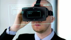 Businessman with vr headset and virtual projection stock footage