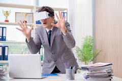The businessman with vr virtual reality glasses in office Stock Photo