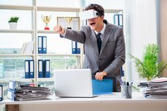 The businessman with vr virtual reality glasses in office. Businessman with VR virtual reality glasses in office Stock Images