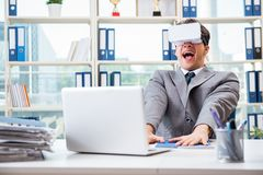 The businessman with vr virtual reality glasses in office Stock Photos