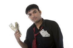 Businessman with wads of money Stock Photos