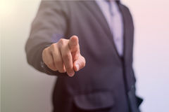 Businessman wagging finger. On blur background Stock Images