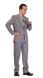 Businessman Waiting. Full-length view of a businessman waiting and looking at his pocket watch Stock Photography