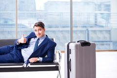 Businessman waiting at the airport for his plane in business cla. Ss Stock Photo
