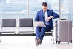Businessman waiting at the airport for his plane in business cla. Ss stock images