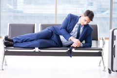 Businessman waiting at the airport for his plane in business cla. Ss Royalty Free Stock Photos