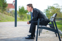 businessman waiting on a bench in park Royalty Free Stock Photography
